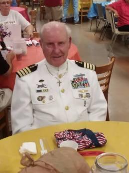 CC Veterans Museum white suit general